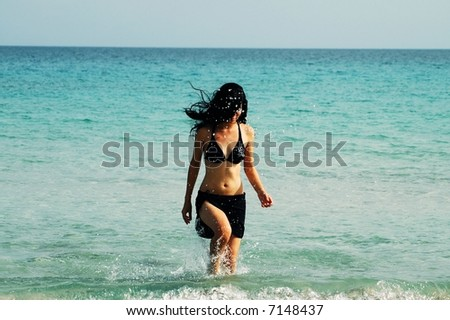Girl walking out the beach