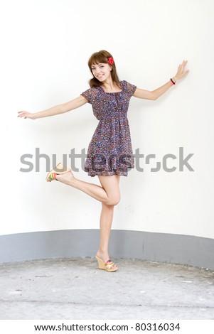 Girl walking outdoor in summer - stock photo