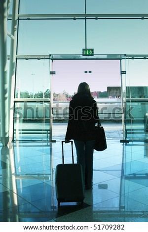 girl walking to the airport door - stock photo