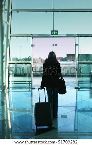 girl walking to the airport door - stock photo