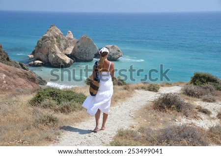 Girl walking to the beach near Aphrodite birthplace, Cyprus - stock photo