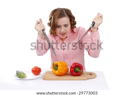 Girl wants to eat sweet peppers. Pretty woman with peppers. Housewife with sweet peppers. Isolated over white background. - stock photo