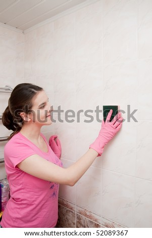 girl washes a tile in bathing