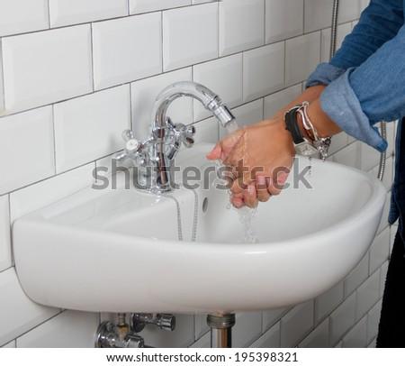 girl washing her hands - stock photo
