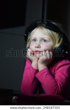 girl watching a movie - stock photo