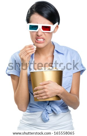 Girl watching 3D cinema in spectacles with bowl full of popcorn, isolated on white - stock photo