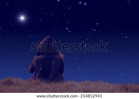 Girl watching the stars. Stars are digital illustration.