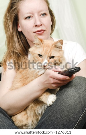 girl watching tv with cat