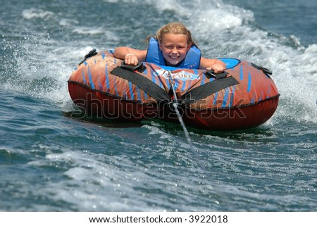 Girl Water Tubing with a Smile - stock photo