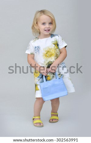 Girl wearing a floral dress - stock photo