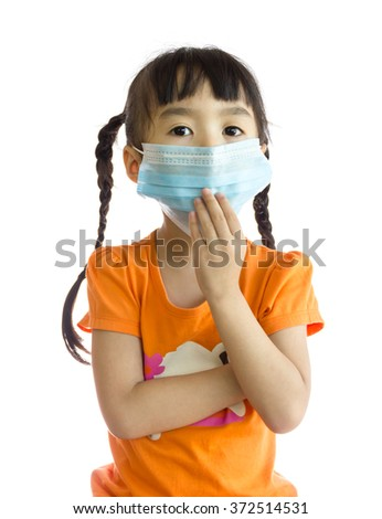 Girl wearing a mask to prevent dust and germs. - stock photo
