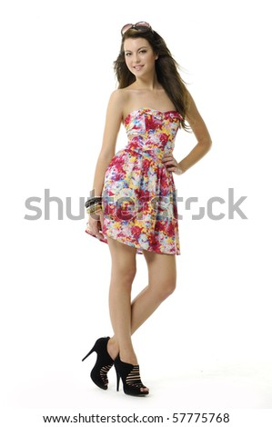 girl wearing a summer dress with sunglasses on her head