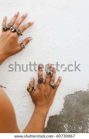 Girl wearing antique handcrafted Turkish rings with grunge patterns and precious stones - stock photo