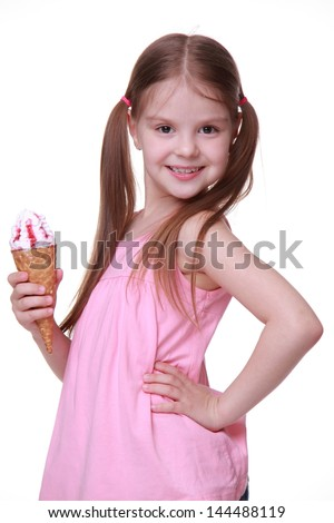 girl wearing blue jeans shorts and pink T-shirt on Beauty and Fashion theme/European young model with funny two tails and holding sweet ice-cream - stock photo