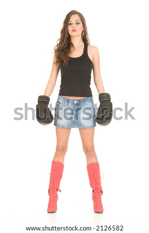 Girl wearing boxing gloves, isolated