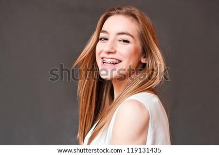 girl wearing braces - stock photo