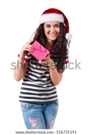 Girl wearing christmas hat for santa with gift box, isolated on white background - stock photo