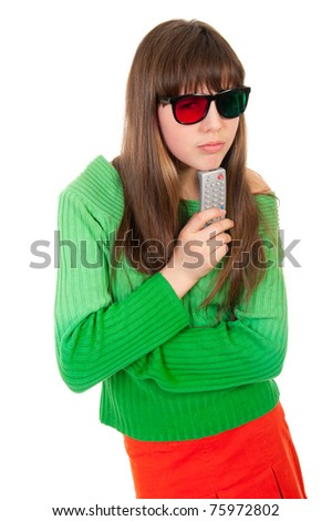 Girl wearing 3D glasses holding remote control isolated over white background - stock photo