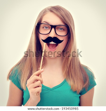 Girl wearing funny  glasses  and fake mustaches. - stock photo