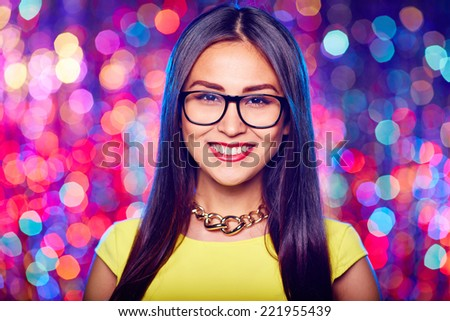 Girl wearing glasses in nightclub - stock photo