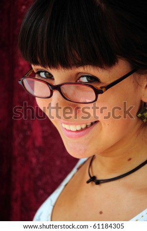 Girl wearing glasses smiling - stock photo