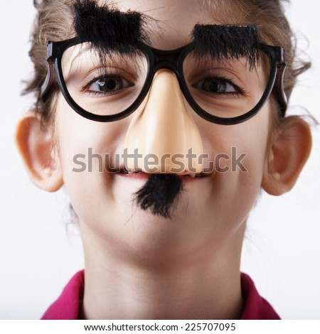 Girl Wearing Groucho Glasses - stock photo
