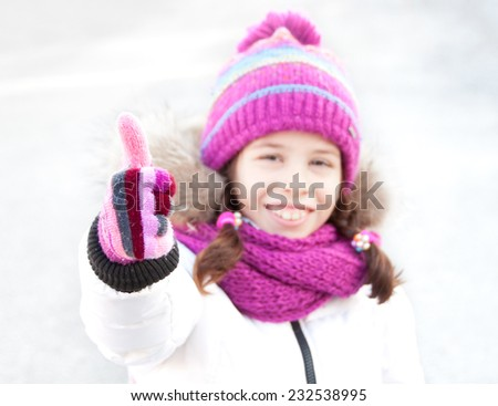 Girl wearing hat, scarf and mittens - stock photo