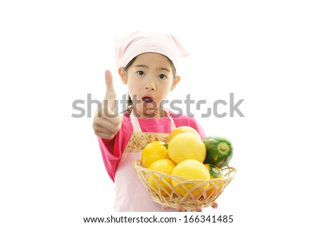Girl wearing kitchen apron - stock photo