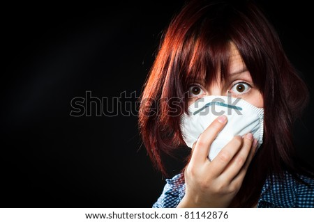 girl wearing protective mask - stock photo