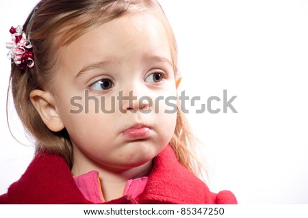 girl wearing red coat pouting - stock photo