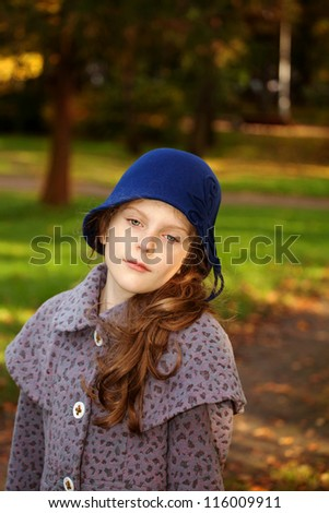 girl wearing retro felt hat and wool coat . Outdoor, Handicraft.