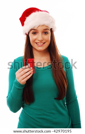 Girl wearing santa hat and holding credit card on white isolated background - stock photo