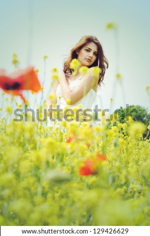 girl wearing white dress standing in the field in retro style - stock photo