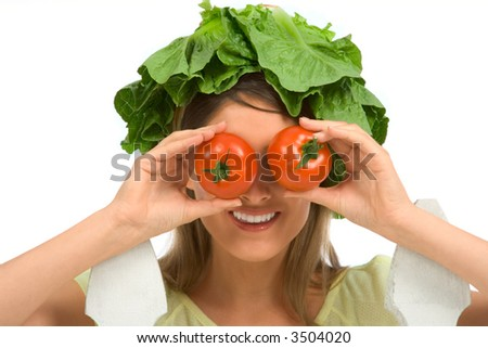 Girl wears lettuce as hat and uses tomatoes as binocular - stock photo