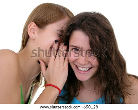 Girl Whispering in Friend`s Ear