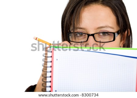 girl who is a student writing on a note pad and wearing glasses isolated over a white background