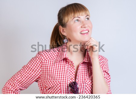 girl who thinks and looks up - stock photo