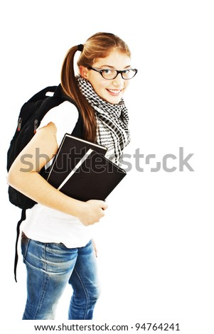 Girl with a backpack and the book. Isolated over white background - stock photo