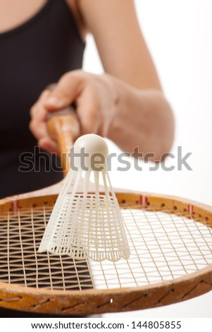 girl with a badminton racket, isolated on white - stock photo