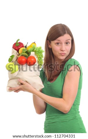 Girl with a bag of fruits and vegetables
