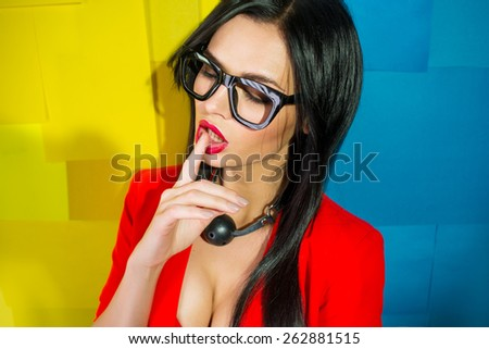 Girl with a ball on the neck from a sex shop - stock photo