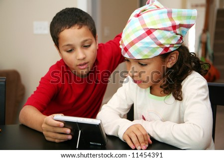 Girl with a bandana on with her brother - stock photo