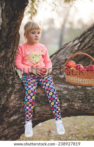girl with a basket of apples tree