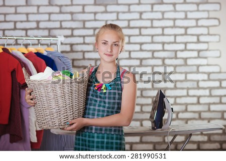 Girl with a basket of clothes - stock photo