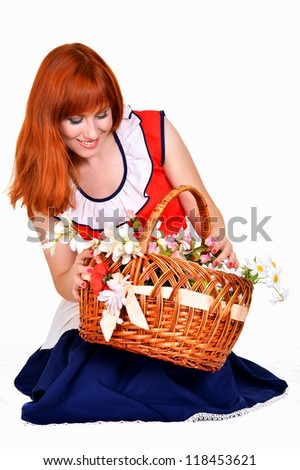 girl with a basket of flowers on a white background