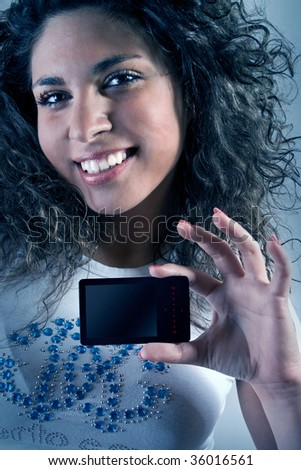 Girl with a beautiful smile and music player.