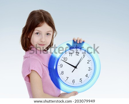 girl with a big clocknew year, warm clothing,happiness concept,happy childhood,carefree childhood,active lifestyle