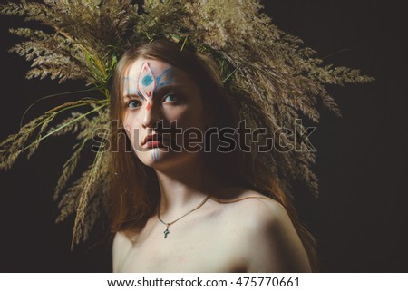 Girl with a big wreath on the head