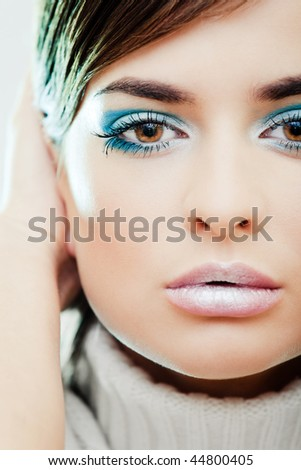 Girl with a blue makeup portrait - stock photo