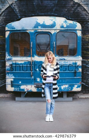 girl with a book at graffiti and subway train - stock photo